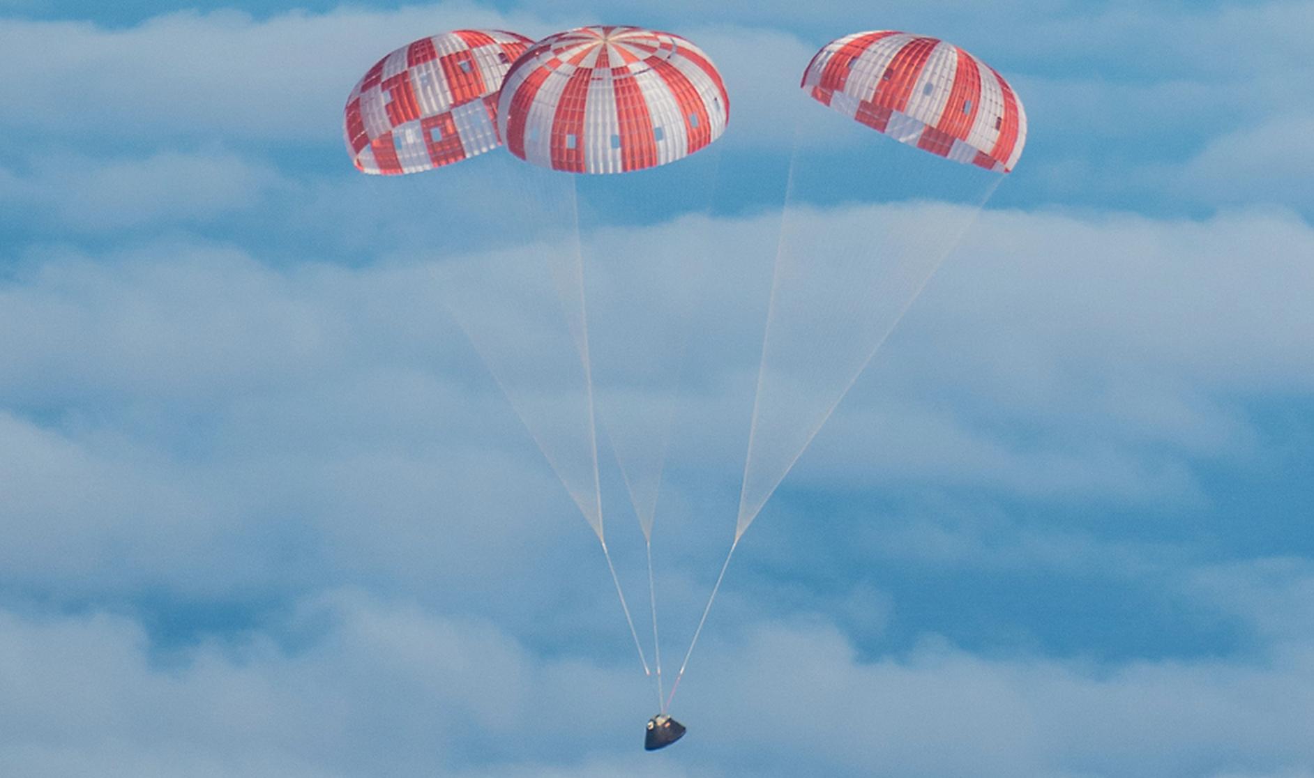 NASA's Orion spacecraft glides through clouds