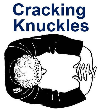 Cracking his knuckles