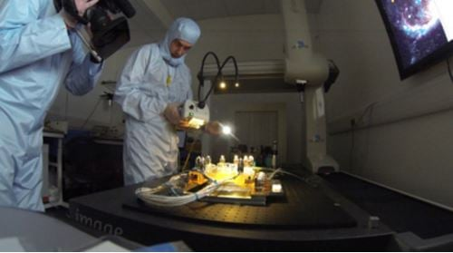 Scottish scientists testing optical bench
