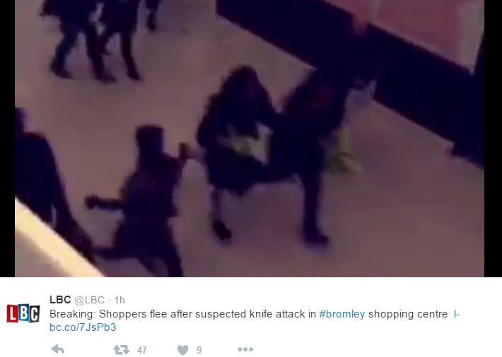 Shoppers flee as man with machette attacks a woman