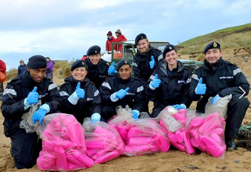 Bright pink bottles being collected by volunteers