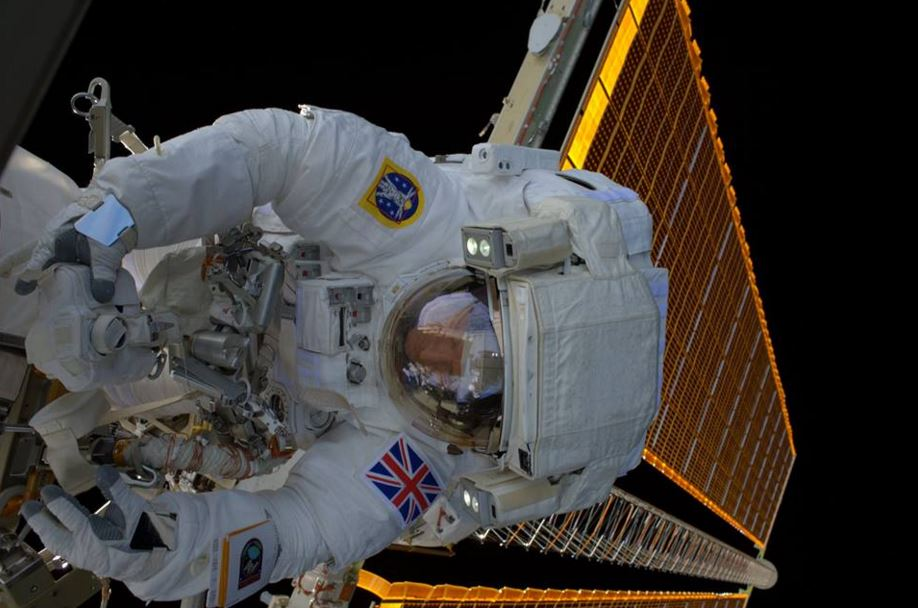 Major Peake fixing solar power unit during spacewalk