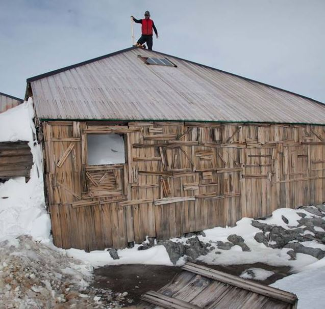 Marty Passingham working on the roof of Mawsons Hut