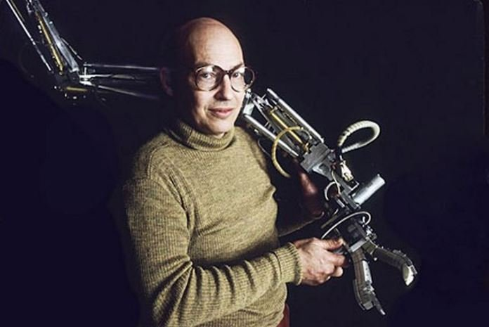 Marvin Minsky with robotic arm