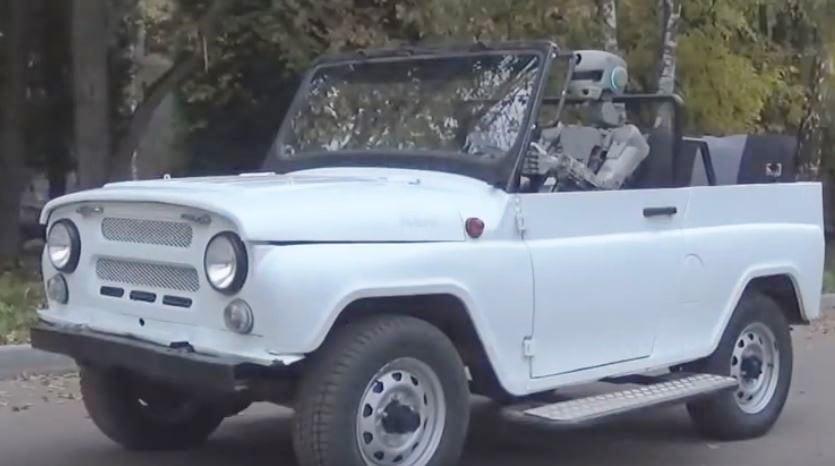 Russian Robot drives a car