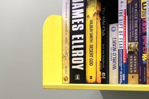 physical books on yellow bookshelf - pixabay 846984
